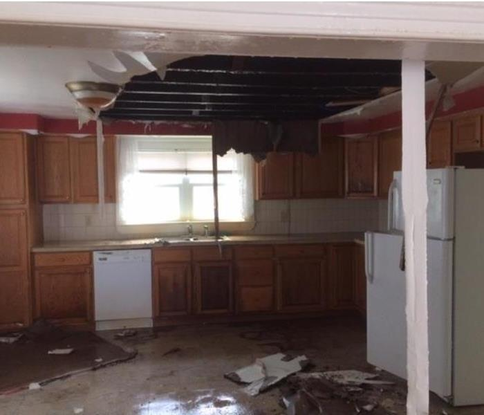 Collapsed ceiling with water damage to the kitchen