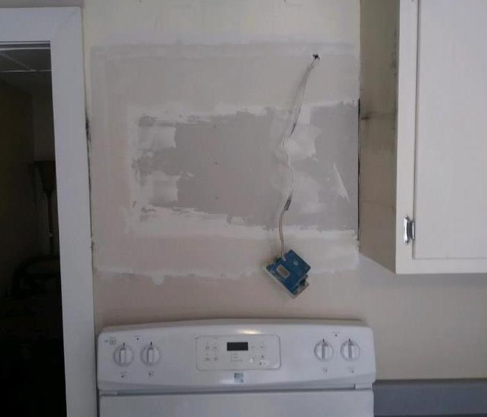 Patched wall after Microwave Fire